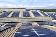 Free Solar PV Rooftop On Curve Roof Under Beautiful Sky Stock Image - 161063651