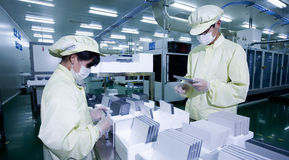Solar R & D center. Workers are working Royalty Free Stock Photography