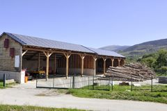 Solar roof of a large surface on a municipal building. Of a small village in the Pyrenees stock images