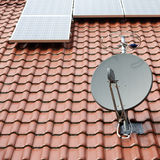 Solar roof with satellite dish Stock Images