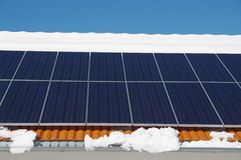 Solar roof in winter Royalty Free Stock Images