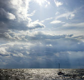 Solar sea landscape. With picturesque clouds and a boat Royalty Free Stock Photo