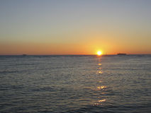 Solar Setting. Setting sun off coast of Waikiki with passing ships Stock Images