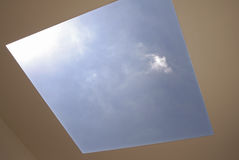 Solar Skylight. Sun and sky as seen through large open skylight. Concept of solar energy Royalty Free Stock Photos
