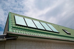Solar system. Solar water heating system on the roof royalty free stock photos