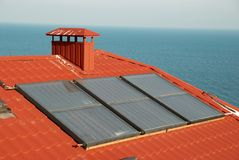 Solar system on the house roof. Alternative energy- solar system on the house roof Stock Images