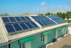 Solar system on the roof. Solar water heating system on the red roof. Gelio panels Stock Image