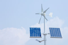 Solar technology. Mini wind turbine and solar panels for providing domestic power Stock Photography