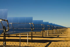 Solar thermal energy. SEGS solar thermal energy electricity plant with parabolic mirrors concentrating the sunlight Royalty Free Stock Images