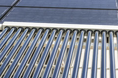 Solar Thermal Flat Panels with Evacuated Tube Collectors. Many companies are installing renewable energy sources II. Solar Thermal Flat Panels with Evacuated Royalty Free Stock Photos