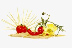 Solar tomato. From macaroni and lasagnas with sharp pepper stock image