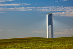 Solar Tower with rays  - thermo-solar power - blue sky and green Stock Images
