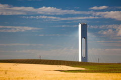 Solar Tower with rays  - thermo-solar power - blue sky and yello Royalty Free Stock Photography
