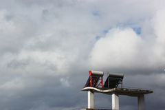 Solar water heater. In cloudy day Royalty Free Stock Photography