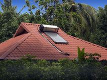 Solar water heater. Sits on the roof of a home in the Maldive islands Royalty Free Stock Photo