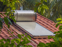 Solar water heater. Sits on the roof of a home in the Maldive islands Stock Images