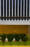 Solar water heater. On a background of green grass and vases Royalty Free Stock Image