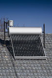Solar Water Heater - Evacuated Glass Tubes. Solar energy, a renewable energy source for water heating. Evacuated glass tubes, method is termed - Heat Exchange royalty free stock images