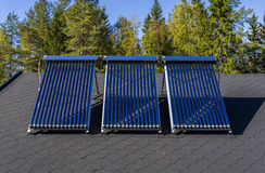 Solar water heater. Installed on a roof stock image