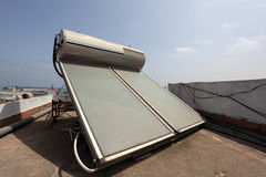 Solar water heater on the roof Stock Photos