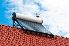 Solar water heater on roof top. Beautiful blue sky background royalty free stock photography