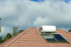 The solar water heater at the rooftop stock photography