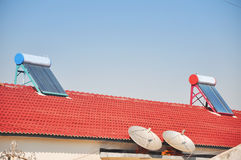 Solar water heater. Two household solar water heaters on roof Stock Photography
