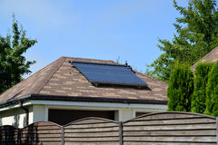 Solar water-heating installation on a garage roof Stock Images