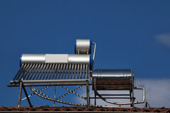 Solar water heating pipes on roof Royalty Free Stock Image