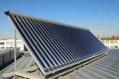 Solar water heating SWH systems use solar panels. Called collectors, fitted to your roof. Energy efficiency concept. Solar Hot water panels heating Royalty Free Stock Photo