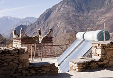 Solar water heating system. On the roof of a traditional tibetan house, Sichuan province, China Stock Images