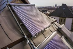 Solar water heating system on house roof. Hot water boiler, alternative ecological sun energy generator. Modern technology concept.  royalty free stock images