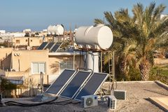 Solar water heating system on a house roof stock photography