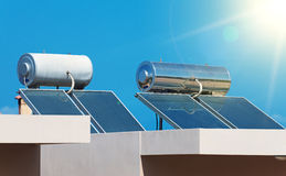 Solar water heating system. Solar water heating system on the rooftops stock photo