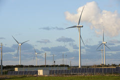 Solar and wind energy. Some wind turbine and photovoltaic panels in South Italy Stock Images