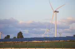 Solar and wind energy. Some wind turbine and photovoltaic panels in South Italy Stock Photography