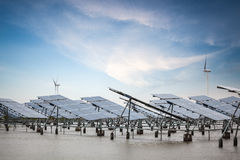 Solar and wind power in coastal mud flat Royalty Free Stock Images