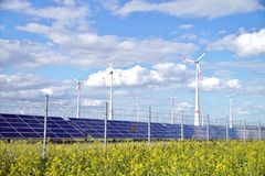 Solar and wind power. Photovoltaic mounted solar panels and wind turbines and renewable Energy. stock photos