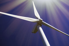 Solar and wind power. Turbine in bright sunshine. Royalty Free Stock Photo