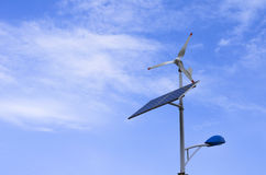 Solar and wind powered light. Street lighting using solar panel and wind generator Royalty Free Stock Photo