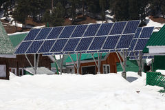 Solarcells on a winter with snow mountain Royalty Free Stock Image