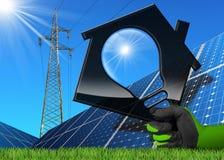 Solarenergie - Haus mit einer Glühlampe Lizenzfreie Stockbilder