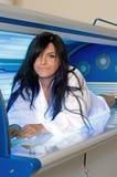 Solarium. Beautiful young woman tanning in solarium Stock Photos