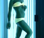 At solarium. Beautiful girl closeup in swimsuit at solarium Stock Images