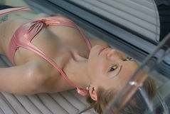 Solarium. Pretty blondy in the solarium Stock Photography
