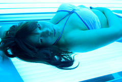 Solarium. Young sexy woman in solarium Royalty Free Stock Photography