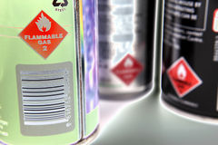 Solarized aerosol cans. A closeup of the warning labels on three spray cans. Picture has a solarzied effect stock images