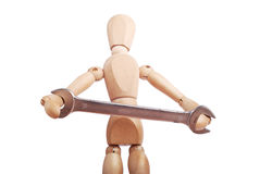 Worker wooden figure with wrench Stock Images
