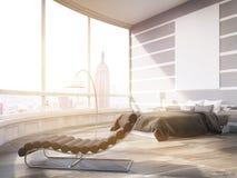 Solbelyst New York City ledar- sovrum i modern lägenhet Royaltyfria Bilder