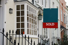 Sold. Beautiful white terraced London house with sold sign stock photo